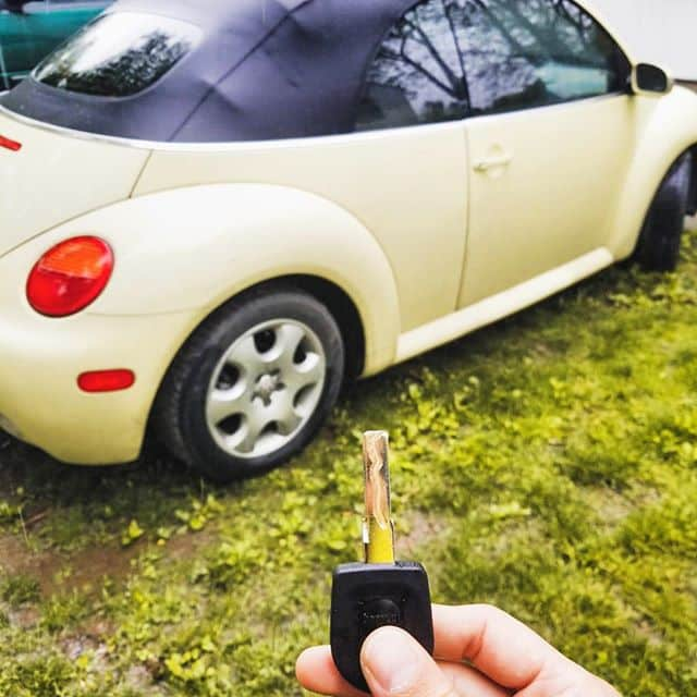 A VW Bug and the new laser cut key we made for them.